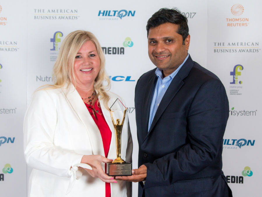 alex george and shellie vornhagen of astute hold gold stevie award at american business awards