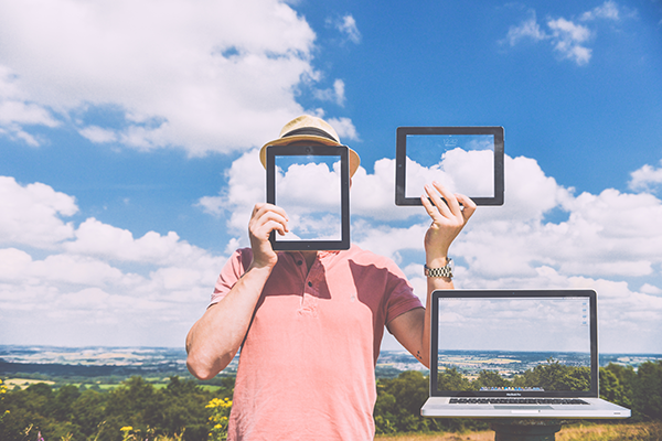 man posing with tablets and clouds