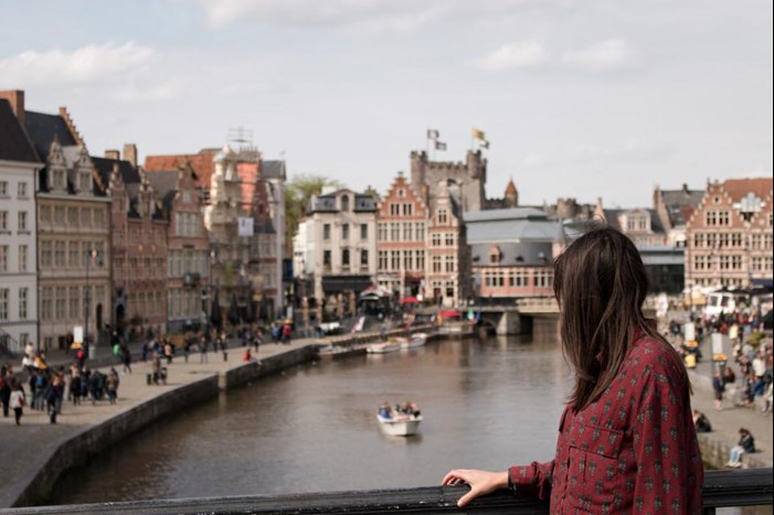 standing on bridge in european city