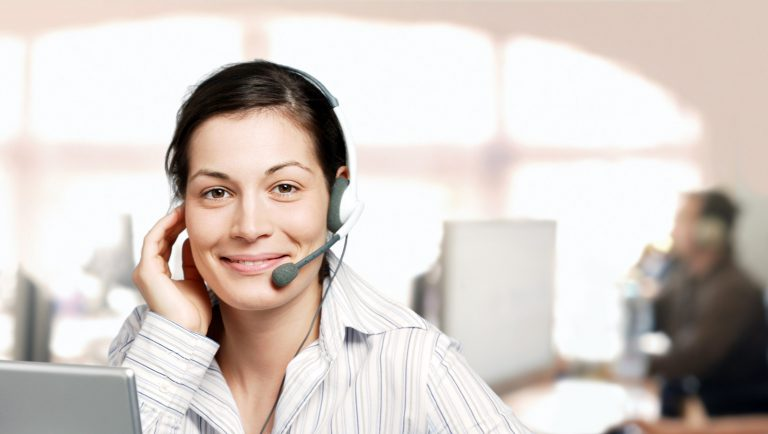 smiling agent in bright call center