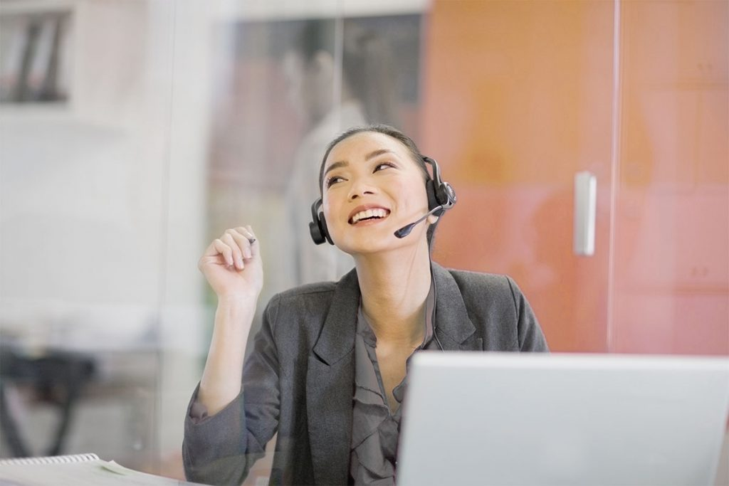 smiling call center agent with headset