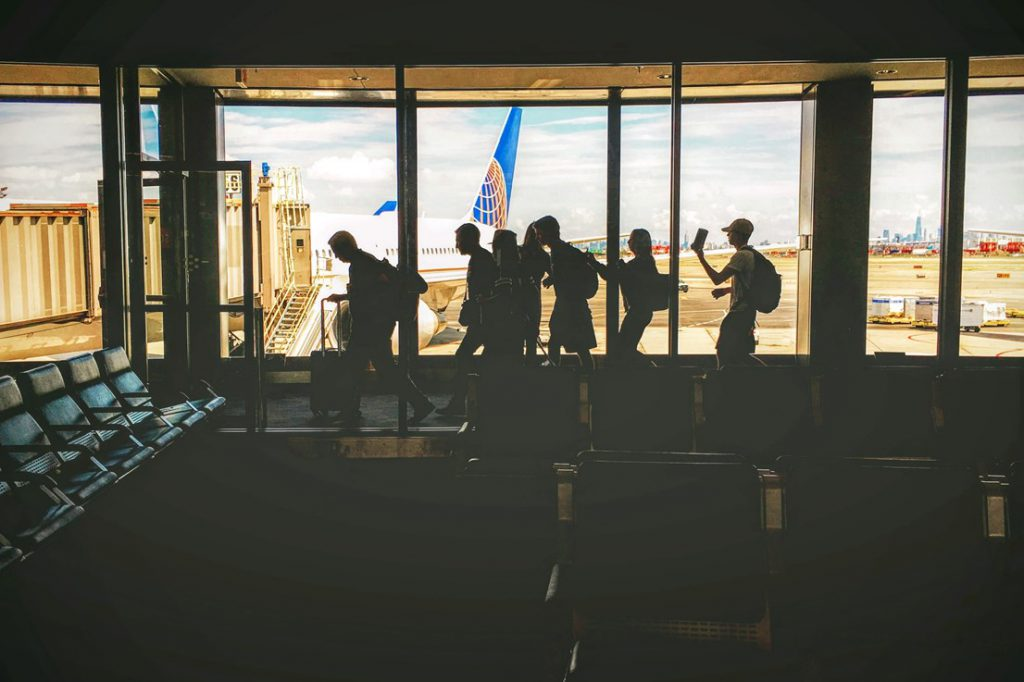 silhouettes against a window airport guest service experience