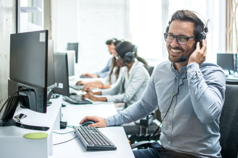 happy call center agent wearing headset