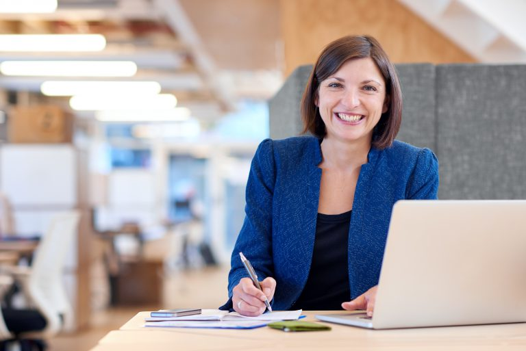 smiling woman working in office