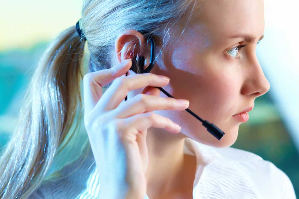 call center agent reviewing customer service survey after call