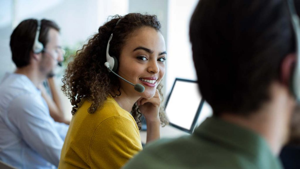 Woman with headset in contact center