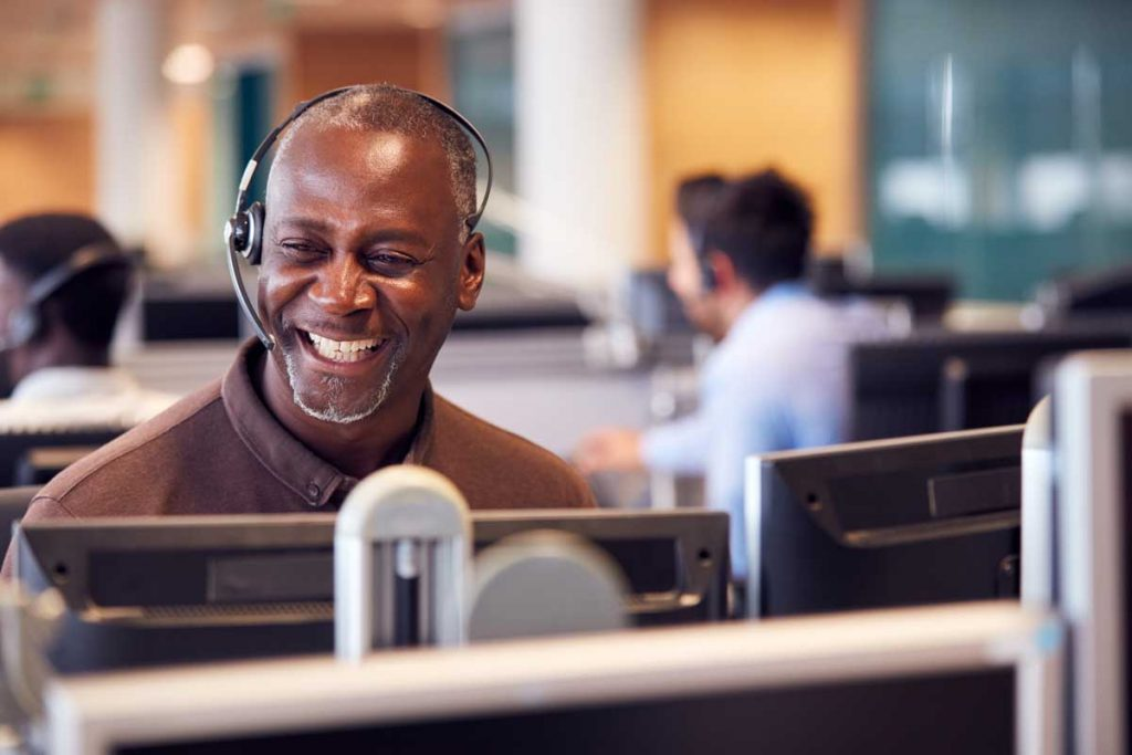 smiling call center agent making use of call center automation for email