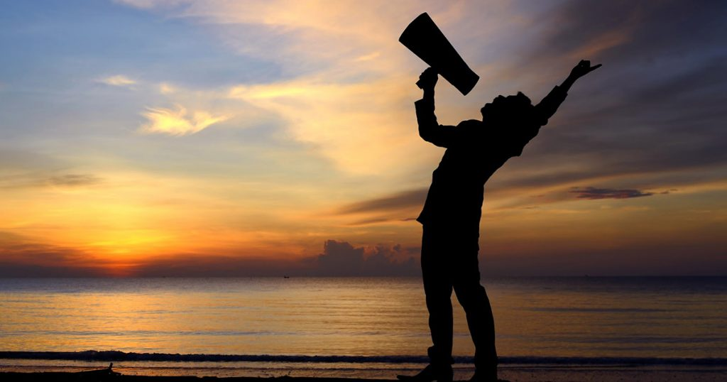 man with a megaphone representing voice of customer